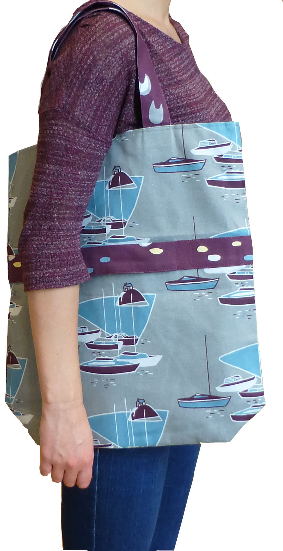 model with unfolded two in one bag in Boats fabric.jpg