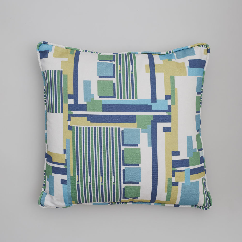 cushion in Kauffman wall green fabric.jpg