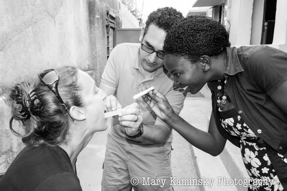 Our Master Trainer, Violah, practicing physical exam skills with Dr. Lisa and Dr. Gabriel, Mbale, 2013 (photo credit  Mary Kaminsky Photography )