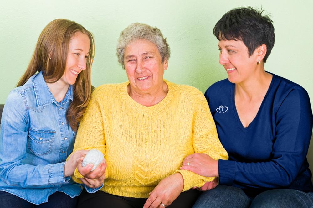 Assurance Home Care nurse embracing elderly patient