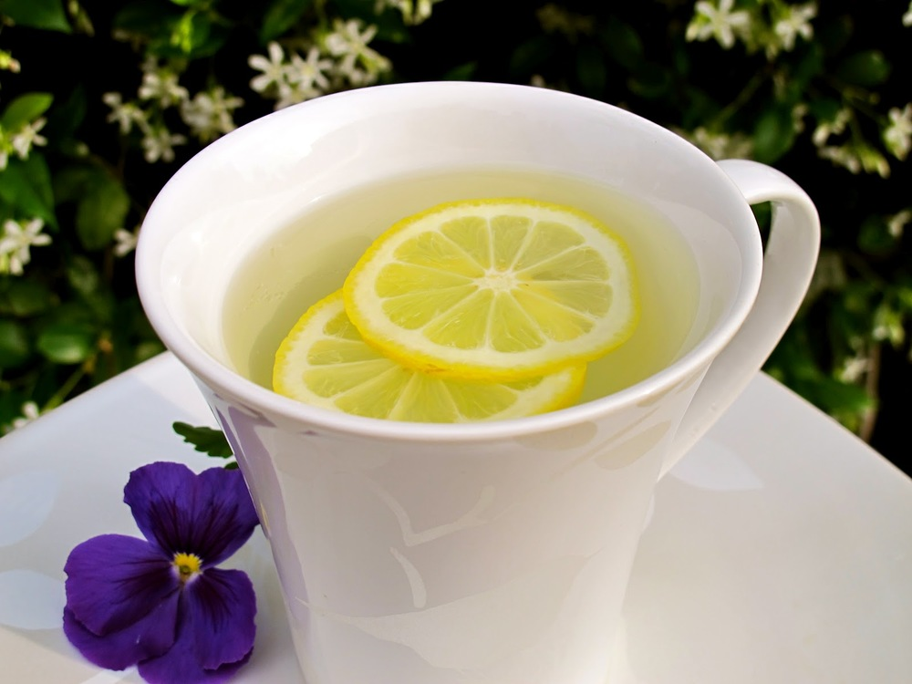 Warm lemon water for natural organic detoxing and cleansing, from holistic health coach, stress reduction, and workplace wellness expert Andrea Rennie of GROW, Grow Happy Grow Healthy
