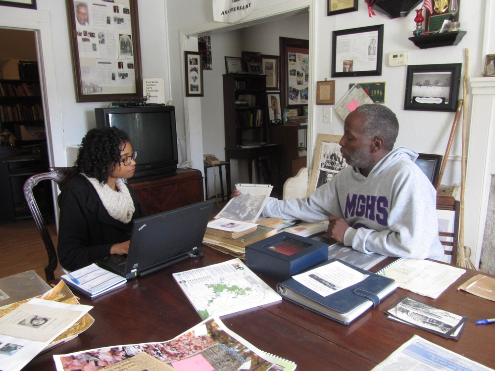 Volunteer archivist JoyEllen Freeman and President Johnny Waits organize archival material.