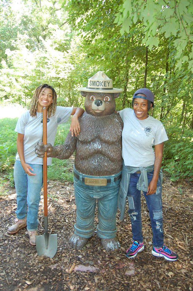 Operation Fresh Start Conservation Academy participants celebrate the end of their summer season with Smokey the Bear!  Photo by Carolyn Byers.
