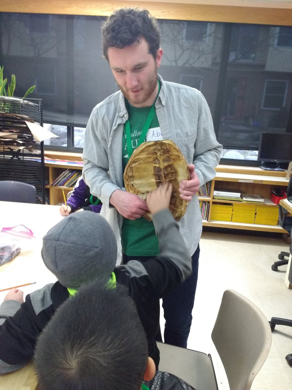 Education intern, Abe, shares a snapping turtle shell with students (Bayview)