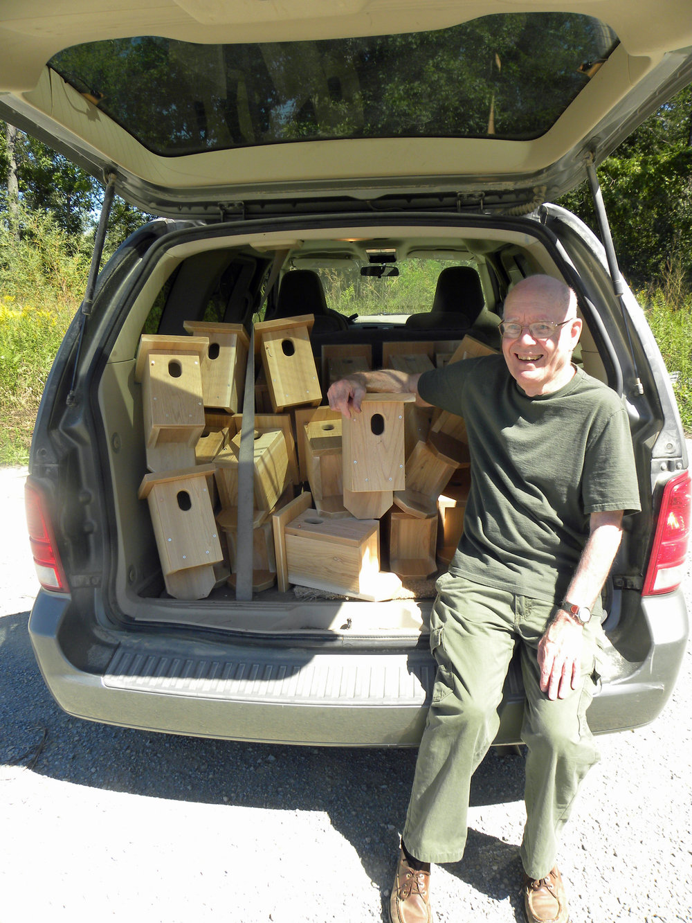 Jerry Martin with the homemade nest boxes. Photo by Mark Martin