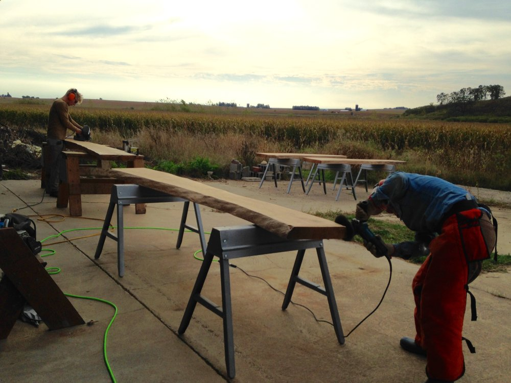 Gorgeous oak slab benches are prepared for installation.