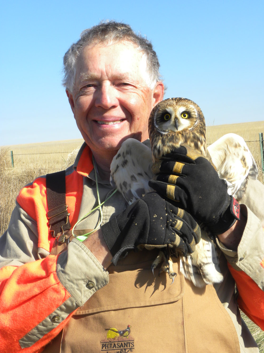 Photo of Mark with the short-eared owl we rescued. Photo by Sue Foote-Martin