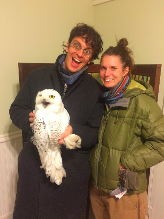 Maddie and her husband Aaron share in the thrill of meeting a snowy owl in January 2018.  Photo provided by Maddie Dumas