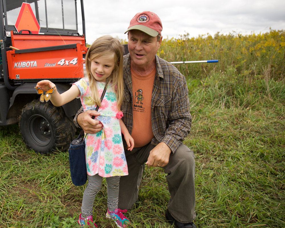 Bob and his granddaughter releasing a newly tagged monarch at Goose Pond in 2016. Photo by Arlene Koziol