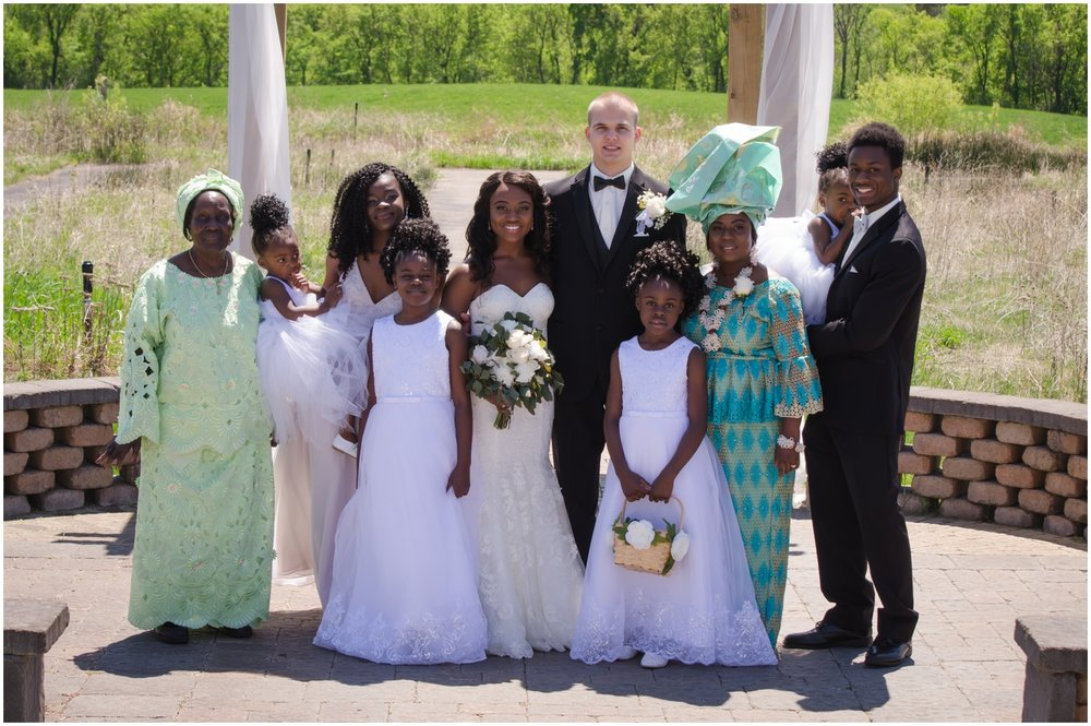 bride and groom with their family