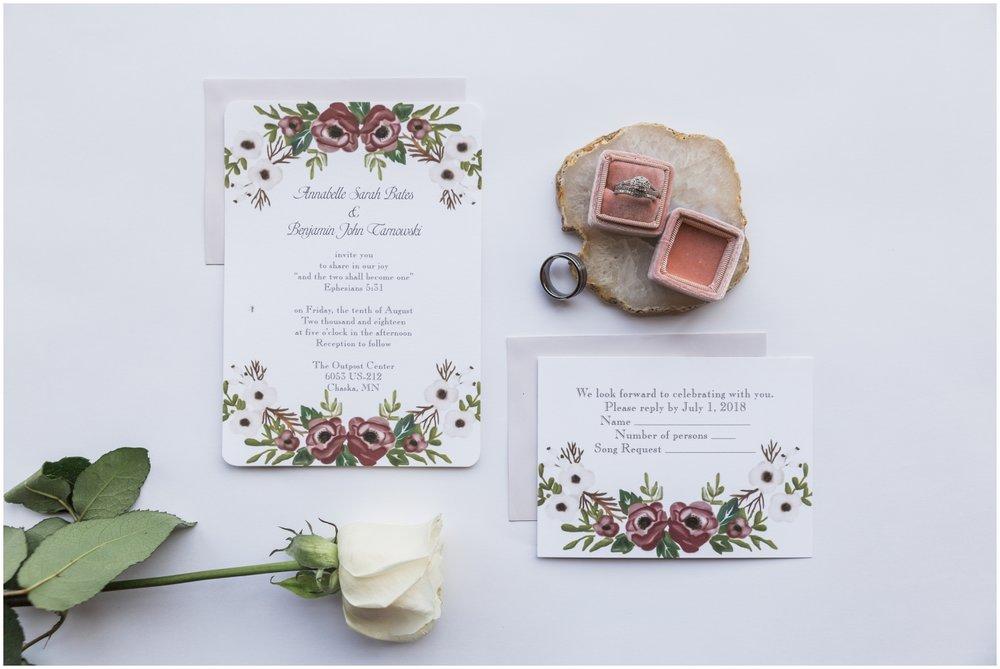 wedding rings and wedding invitation