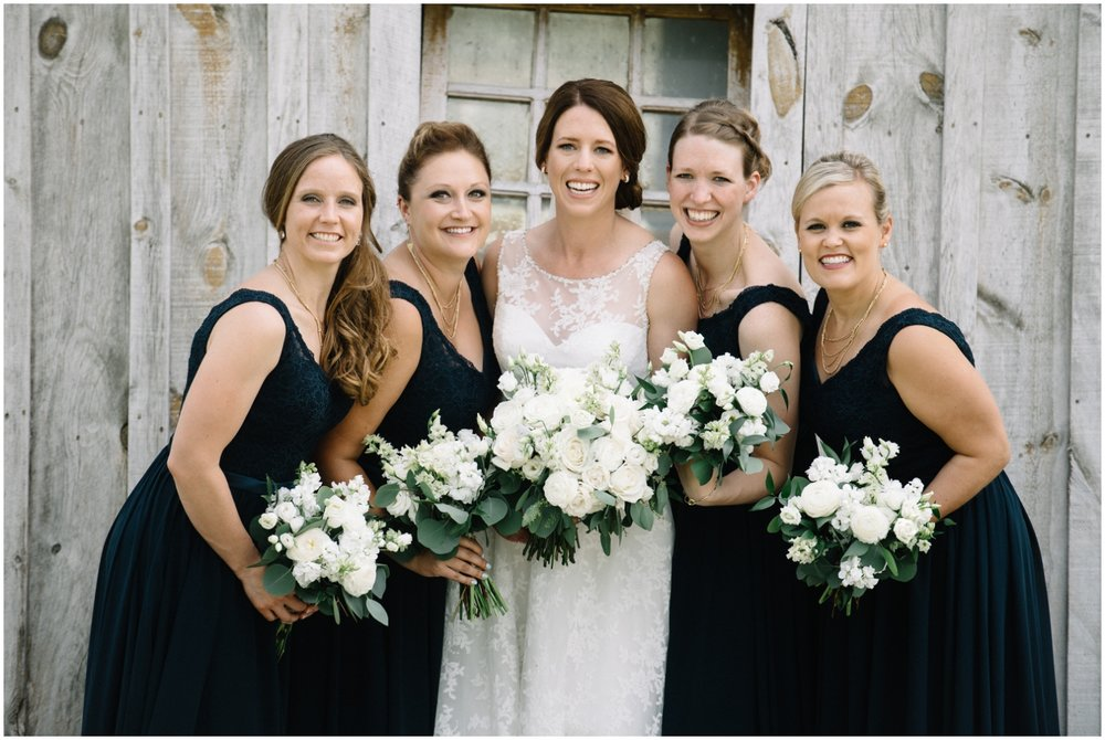 Bridesmaids and the Bride holding wedding bouquets