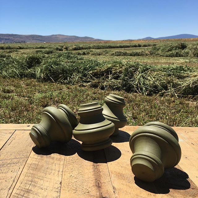 Freshly waxed turned feet drying along with freshly raked hay. Go green! Finishing up furniture for the Farm Fair @countycorkinmerrill Friday and Saturday. #matchiematchie #oregonfarms #farmfair2016 #madeinoregon #countycorkcollectibles #milkpaint
