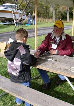 A child learns knot tying at last year's Root River Open House event.