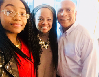 Judy (center), her husband, Jon (right), and their daughter, Jonay (left).