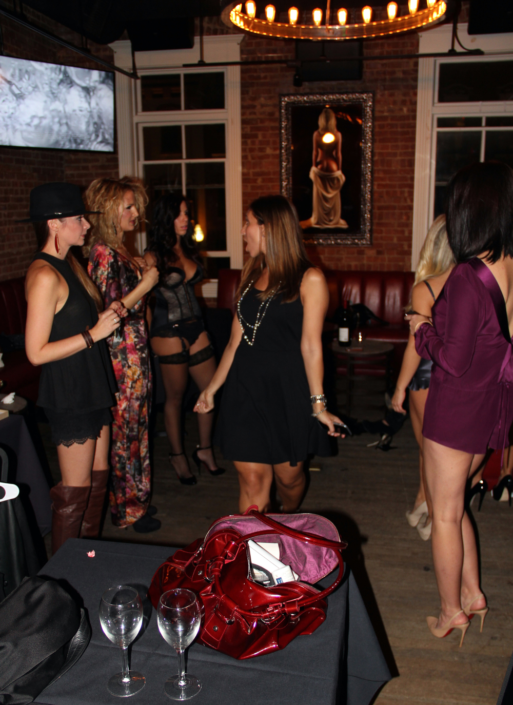 Angie, owner of Sweetest Sin Boutique directing the models before the show.