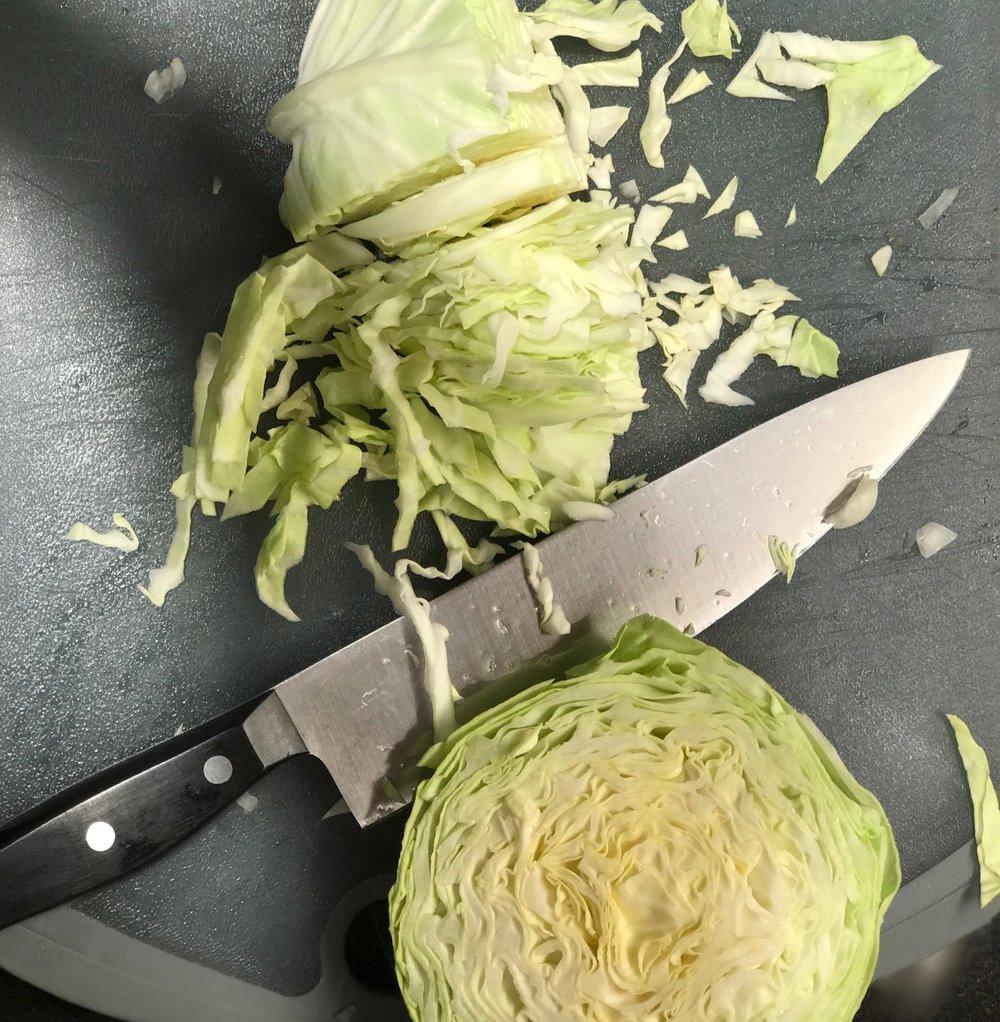 Slice cabbage into shreds.