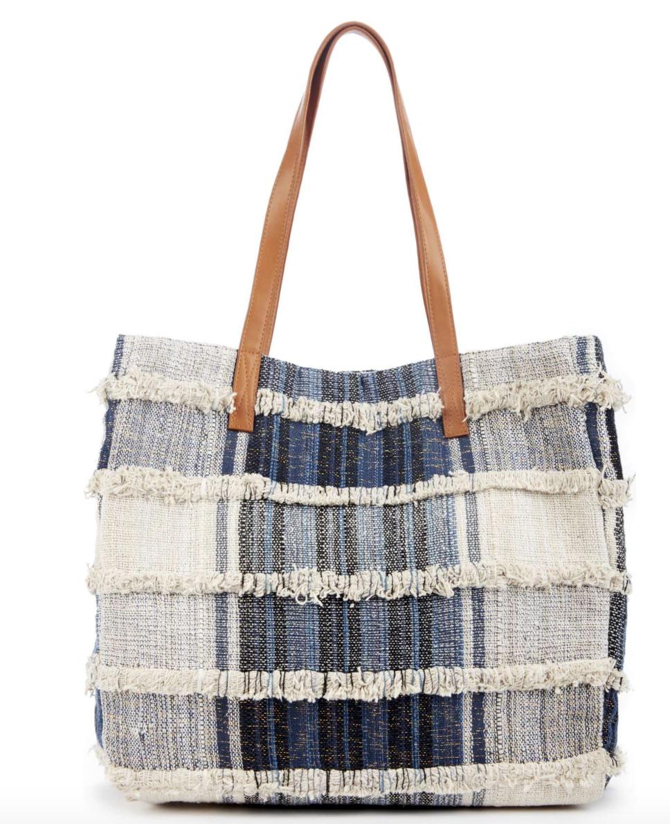 Get this boho, beauty denim bag at   Nordstrom.