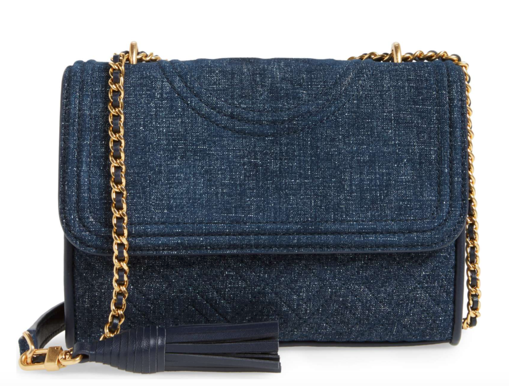 I absolutely love the gold chain on this dark, quilted denim purse! get this gorgeous Tory Burch piece   here .