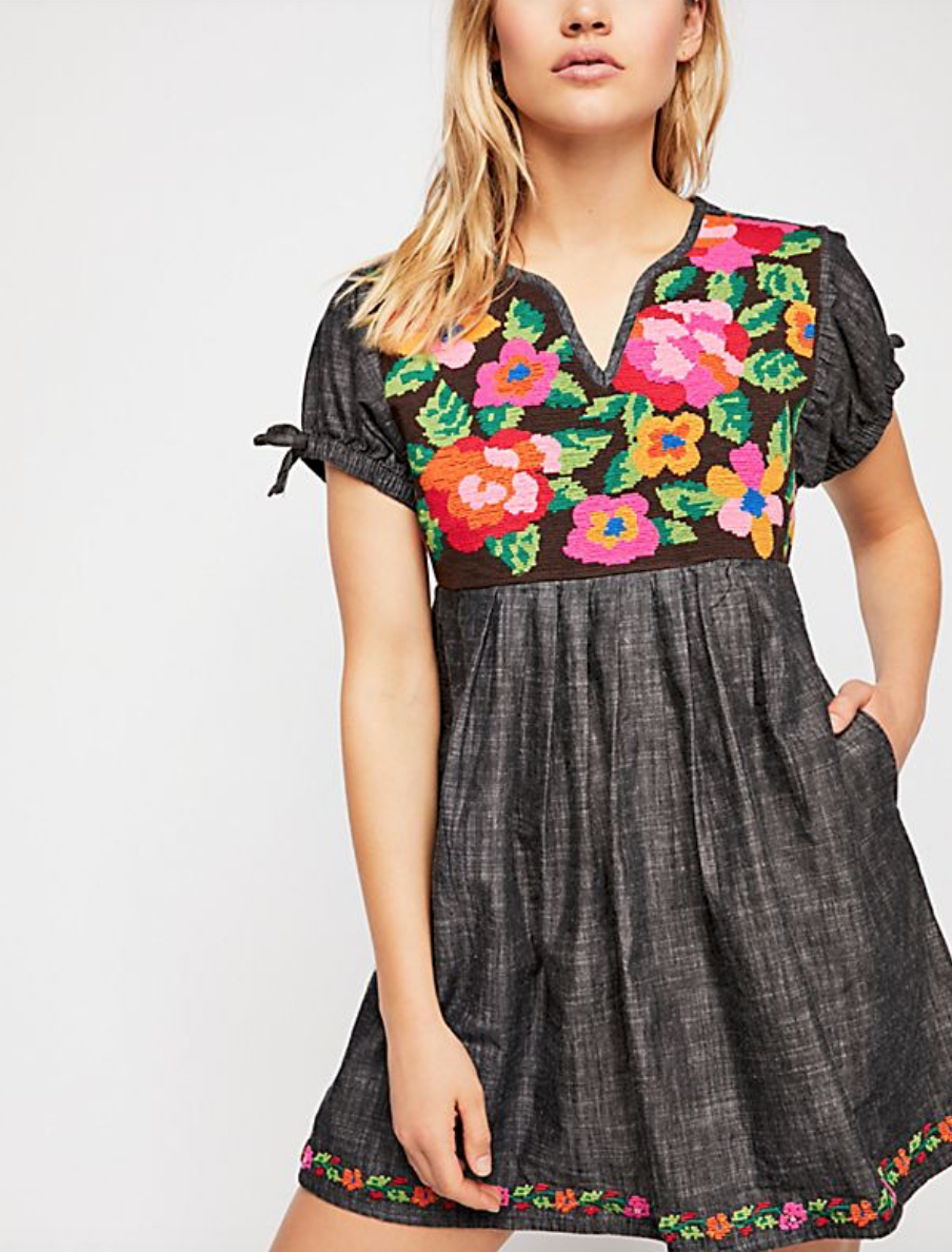 Get this adorable Denim Embroidered mini dress on SALE at   Free People .