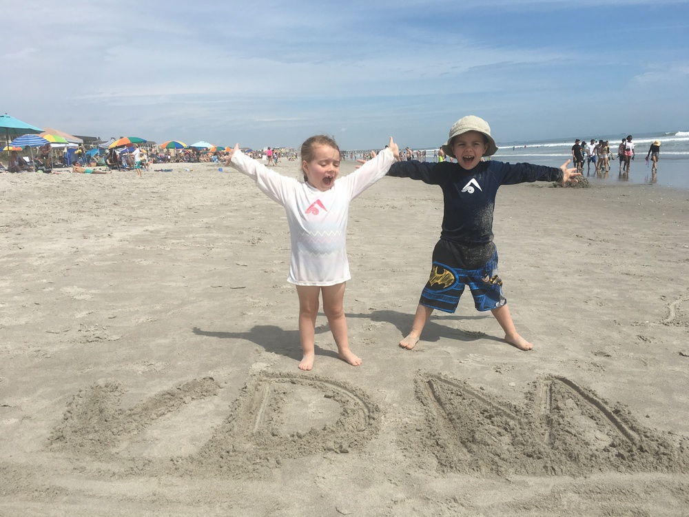 Cade and Evie living it up at Cocoa Beach!  The warm sun.  The blue sky.  Sigh...