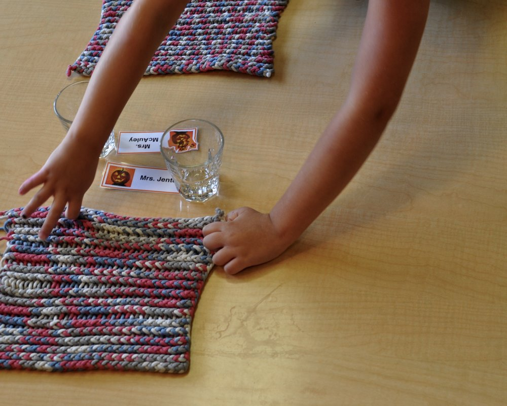 This child took great care in placing the mats just so!