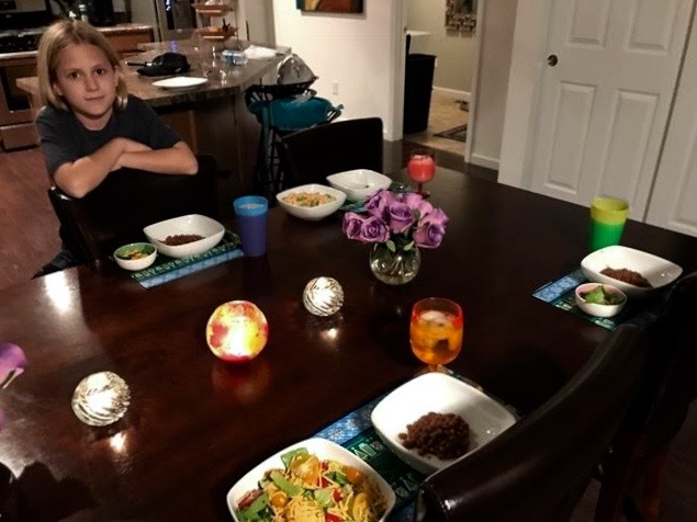 Rachel, posing with her surprise family dinner