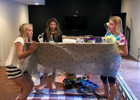 Katelyn and two of her friends making a game for Boo Fest