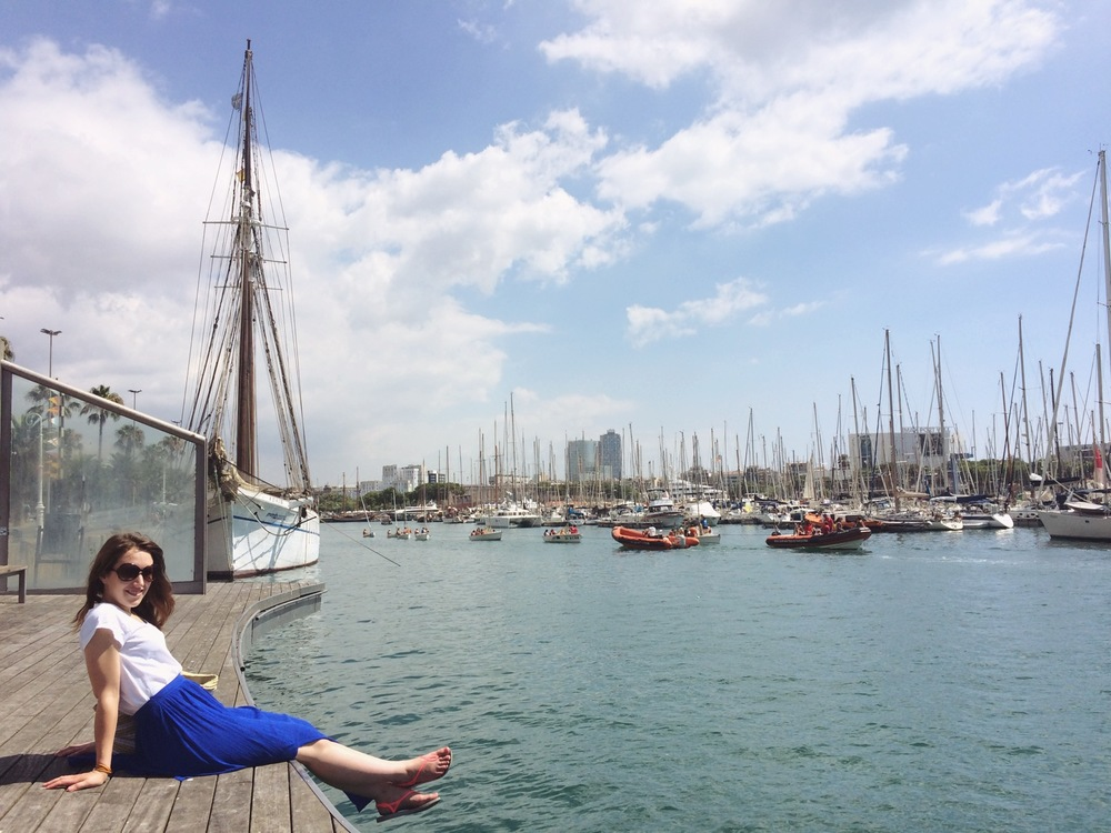 Megan taking in the warmth of the sun on the docks of Barcelona