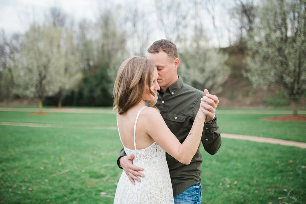 Engagement Photos | I found the one my soul loves. Song of Solomon 3:4 | Pond, meadow, blooming trees.