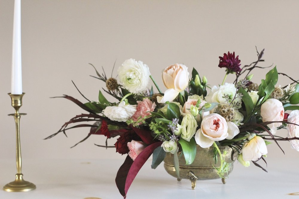 Blush & Burgundy | Compote flower arrangement, blush, oxblood, burgundy, red, garden rose juliet, ranunculus, dahlia, magnolia leaf, lisianthus | Florist: Love Shyla | loveshyla.com