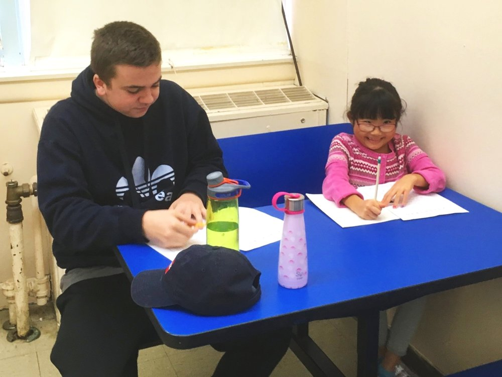 Aidan and a young friend at Amherst Japanese Language School, where he volunteers