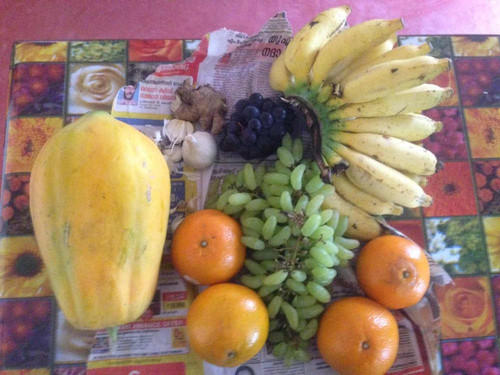 Fruits from Cheruthury and a papaya from the garden!