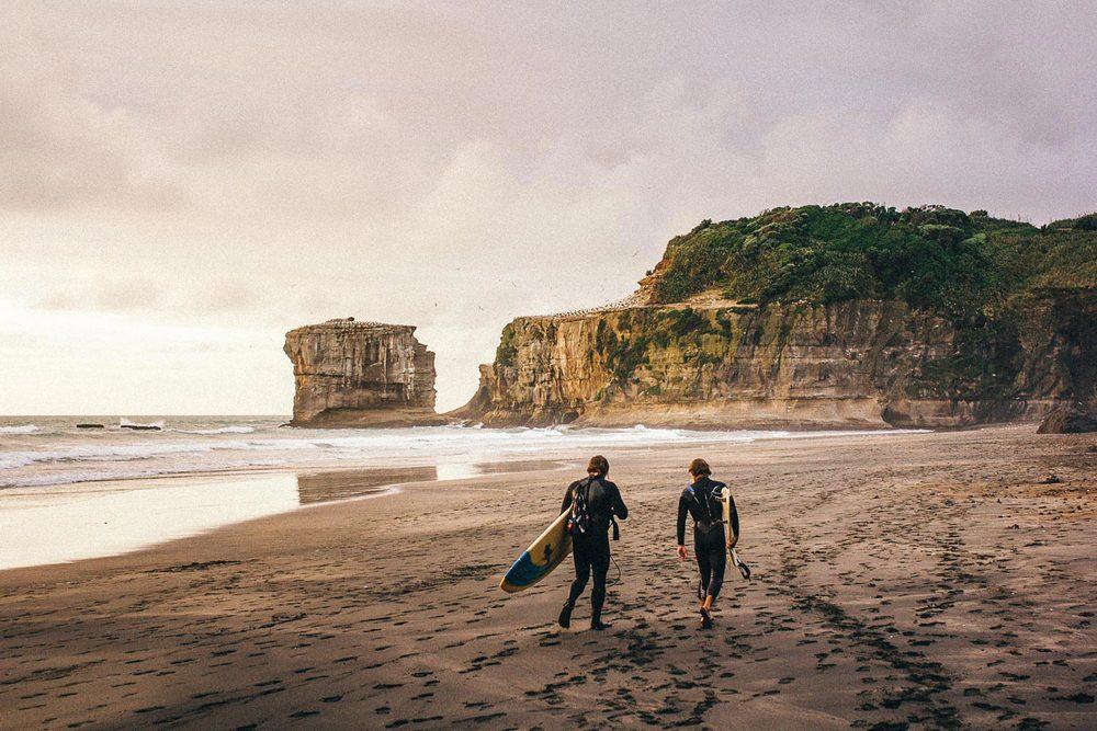 maori-bay-new-zealand-lifestyle-photography-surfers.jpg
