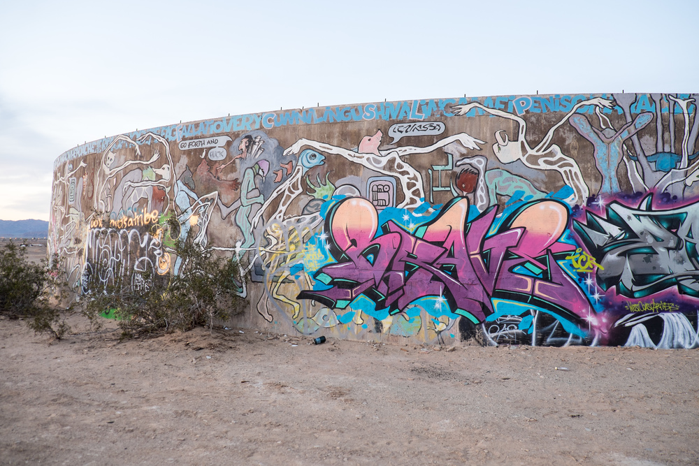 A short walk away, you will find this graffiti. It's incredibly vulgar and a stark contrast to Salvation Mountain.