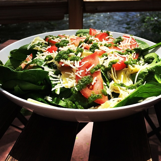 Fresh and Healthy Casanova Salad with Tomato, Spinach, Skhug, Asiago, Artichoke Hearts