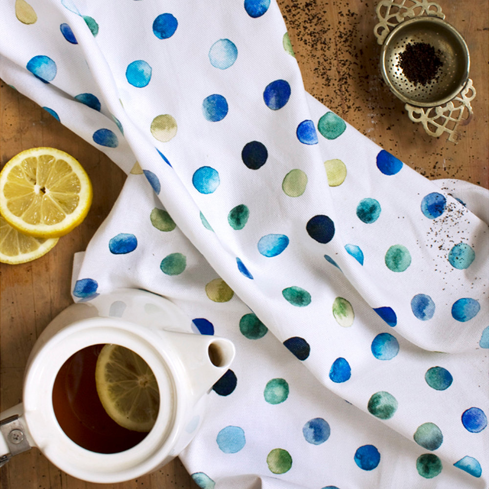Watercolour polka dot tea towel by Lucy King Design