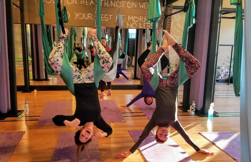 anti gravity aerial yoga class in session