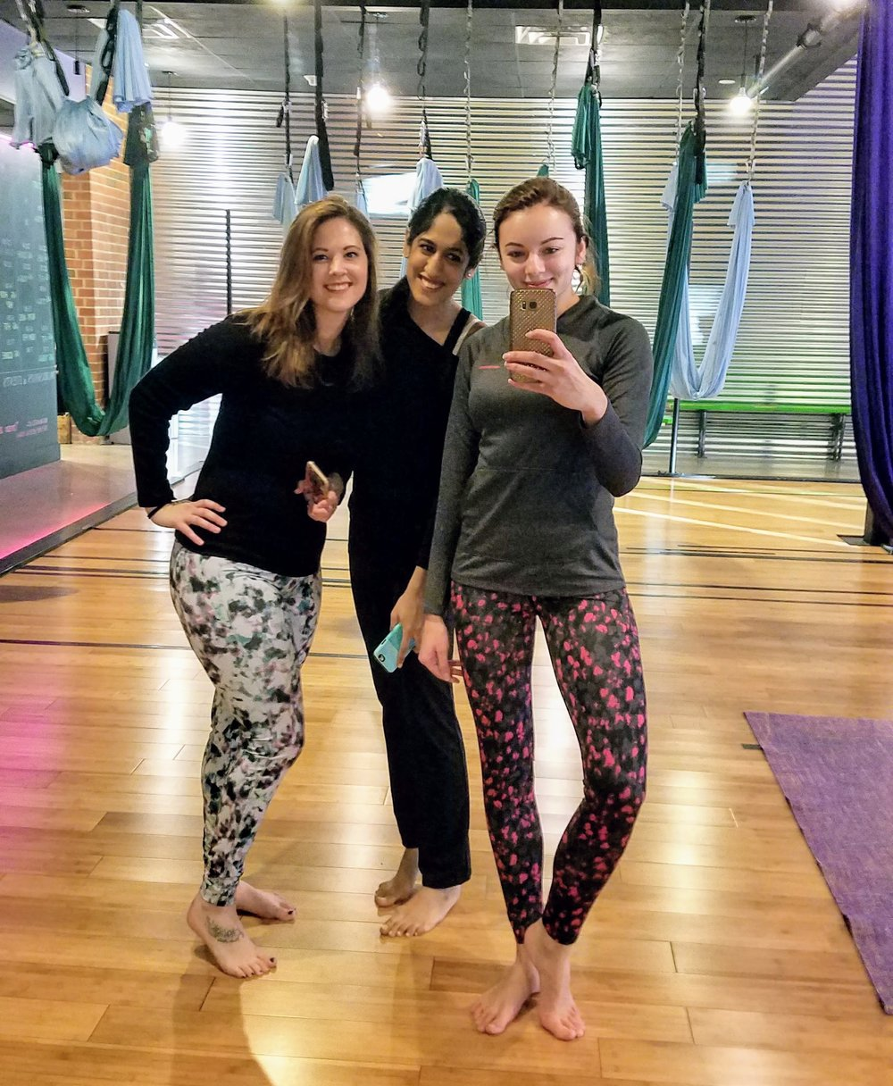 three girls in aerial yoga studio