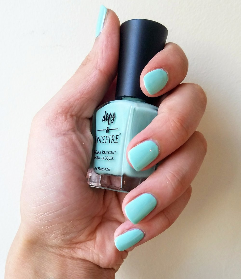 Turquoise nail polish.
