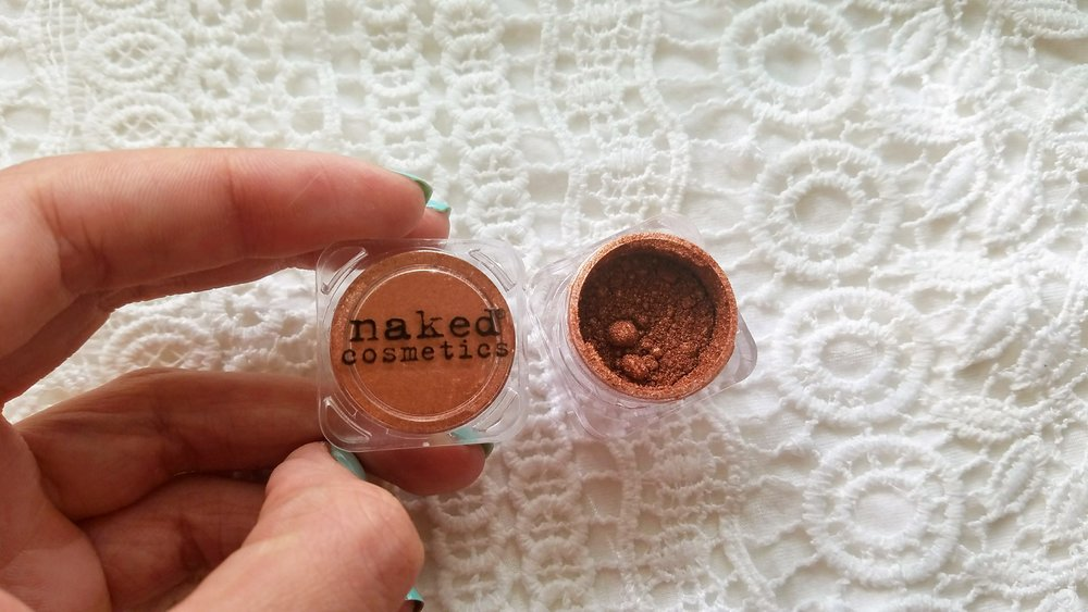 Naked cosmetics metallic copper shade eye-shadow.