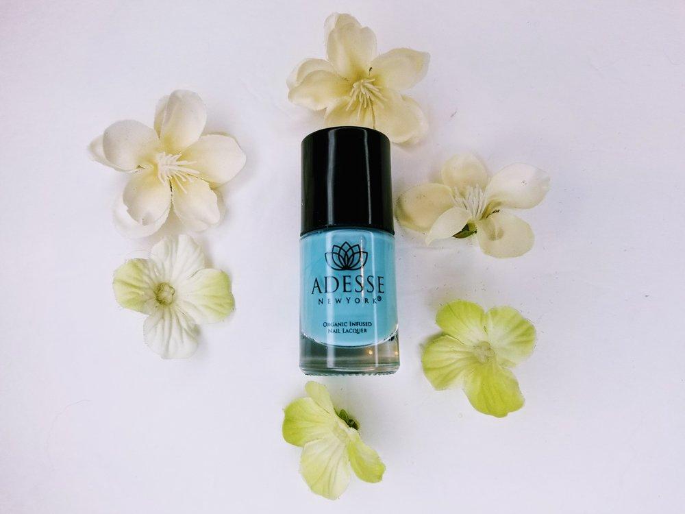 A photo Adesses blue nail polish.