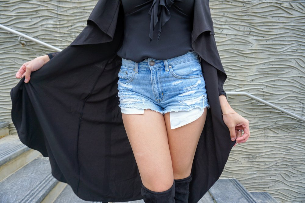 Outfit: jean shorts, black knee high boots, black top and duster.