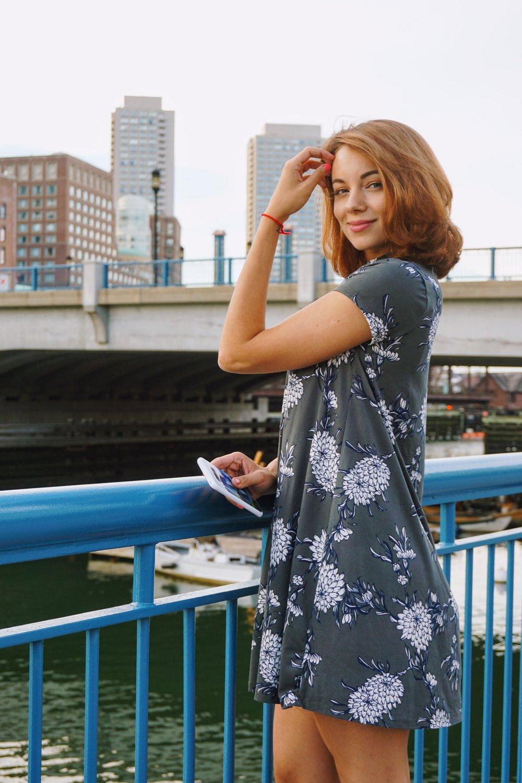 A blogger posing by Boston river.