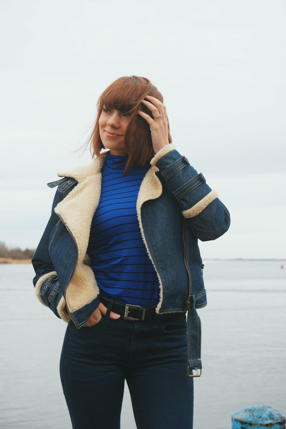 Outfit inspiration: blue turtleneck with black stripes, denim winter jacket, and express jeans.