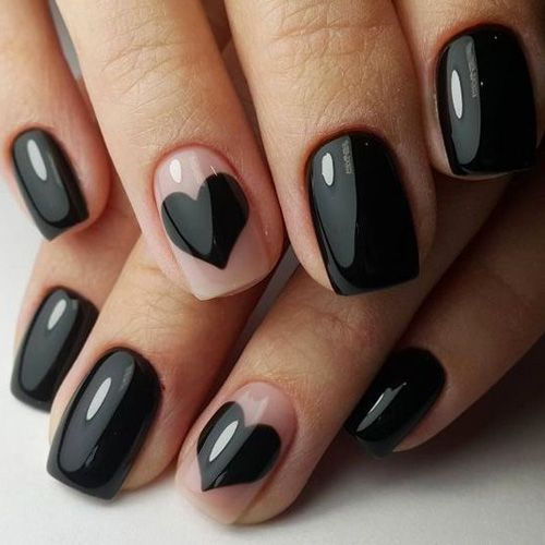 Black and nude nails, with one black heart on one nail.