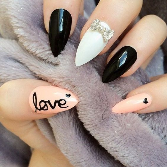 Oval shaped nails, black, pink and white nails.