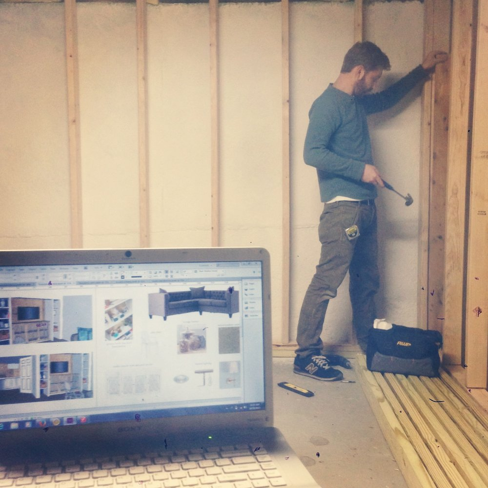 Basement Project - Here is an action shot of David transforming a basement into a living space. This project included several custom built-ins, a media area and a kids play space under the stairs.