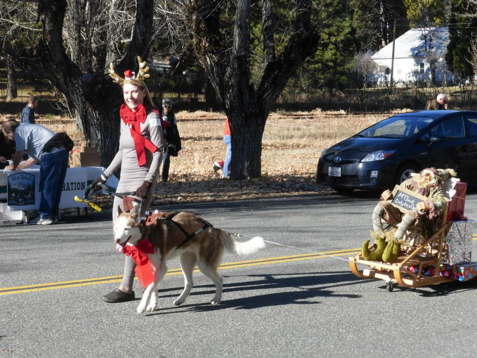 Mary Lingsch and her 'reindeer', Ivan, lead the way in McCloud's Annual Dog, Pony and Bike Parade