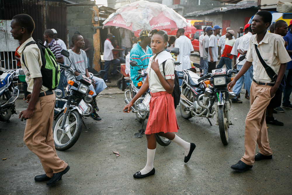 Teenagers walk to school in Cap-Haïtien, Haiti's second largest city in the north. Alex Proimos [CC License]